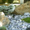 Boulder garden by Backyards Plus.
