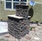Side shot of the back of an outdoor fireplace.