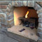 Wood burning outdoor fireplace by Backyards Plus.