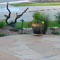 Alternating colored flagstone patio.