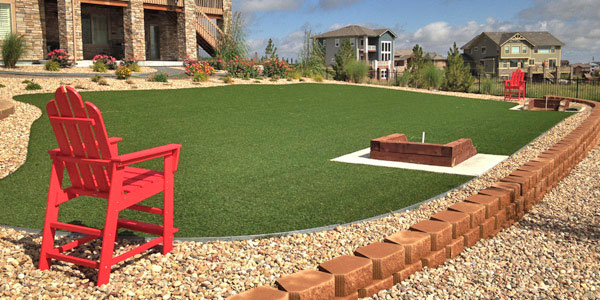 Artificial grass lawn with a built in horse shoe pit.