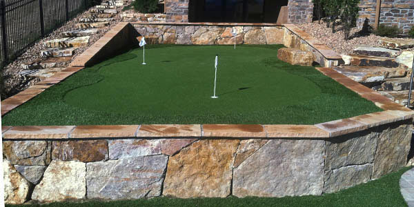Synthetic putting green by Backyards Plus.