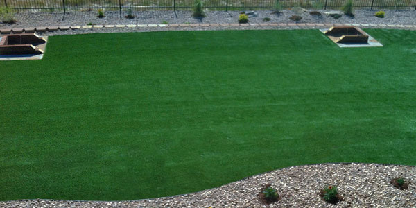 Fake grass in a Colorado backyard.