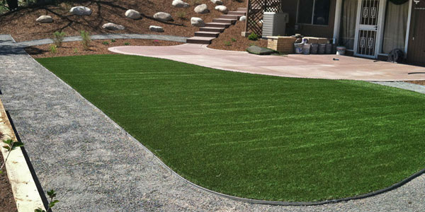 Save water with an artificial grass backyard in Denver, CO.