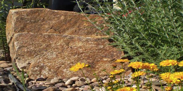 Use large rocks in your Denver landscaping.