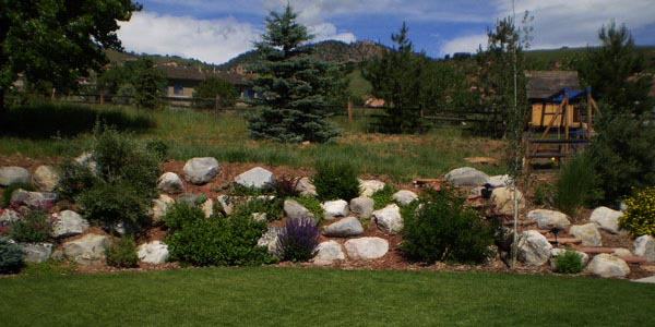 Large boulder placement project by Backyards Plus in Denver, CO.
