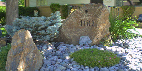 Decorative rock with street address engraving.