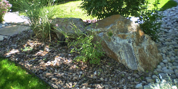 Decorative rock is a popular element in Denver landscaping.