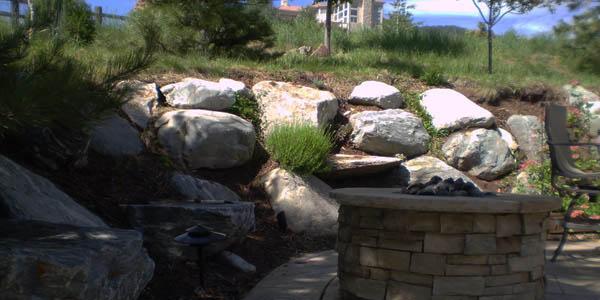 Backyard with large rocks.