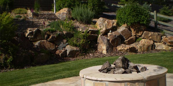 Landscaping with boulders by Backyards Plus.