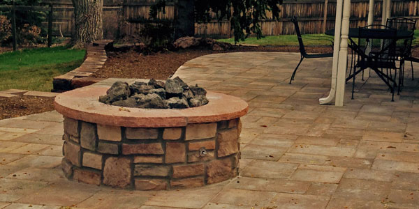 Round natural gas fire pit in Highlands Ranch by Backyards Plus. - Fire Pit Photos