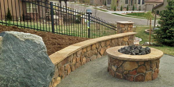 Round flagstone fire pit by Backyards Plus in Golden, CO.