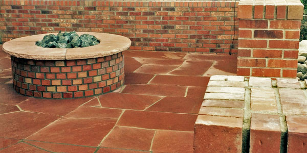 Natural gas fire pit finished in brick.