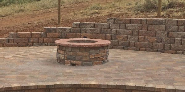 Round fire pit finished with rectangular stone.