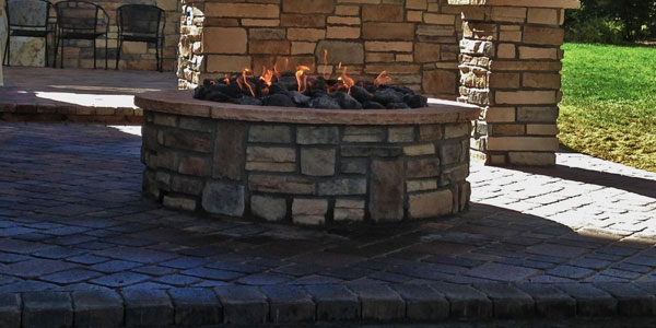 Round fire pit installed by Bakyards Plus in Evergreen, CO.