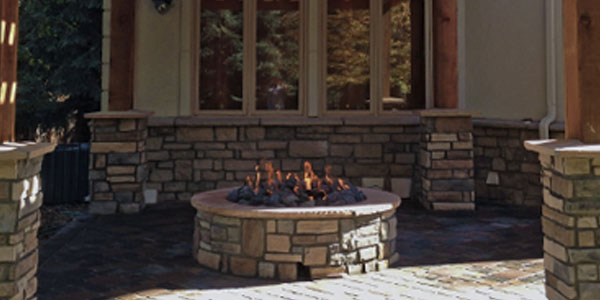 Backyard natural gas fire pit designed and installed by Backyards Plus.