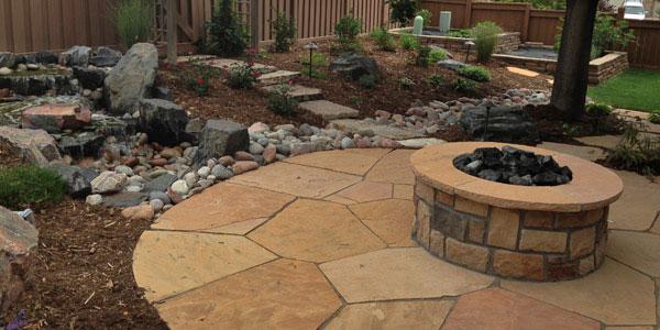 Round, stone, backyard fire pit.