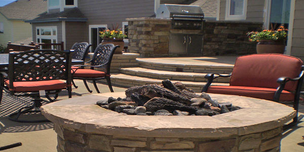Round fire pit in a Highlands Ranch backyard.