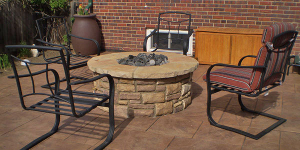 Wheat Ridge, CO yard with a natural gas fire pit for entertaining.