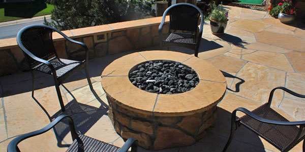 Aerial view of a natural gas fire pit installed by Backards Plus.