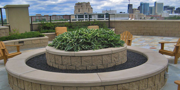 Commercial, round, double-stacked fire pit on a balcony in downtown Denver, CO.
