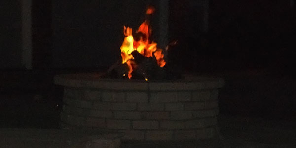 Natural gas fire pit design and installation by Backyards Plus.