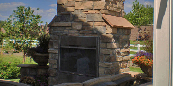 Custom outdoor fireplace design and installation for Denver, CO and the suburbs.