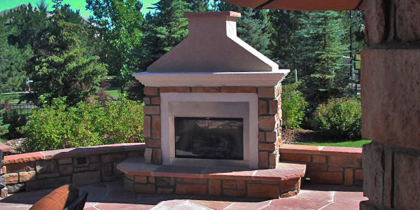 Outdoor fireplace installation in the Denver Foothills by Backyards Plus.