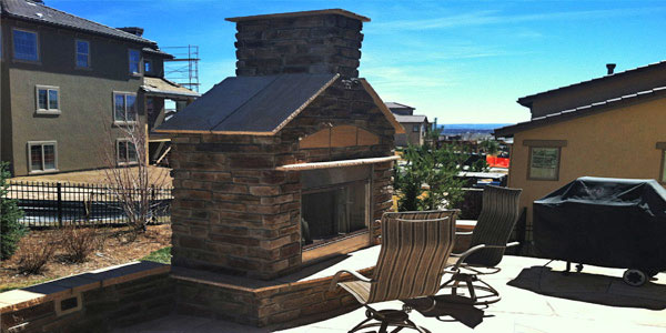 Outdoor fireplace design and installation by Backyards Plus for metro Denver, CO.