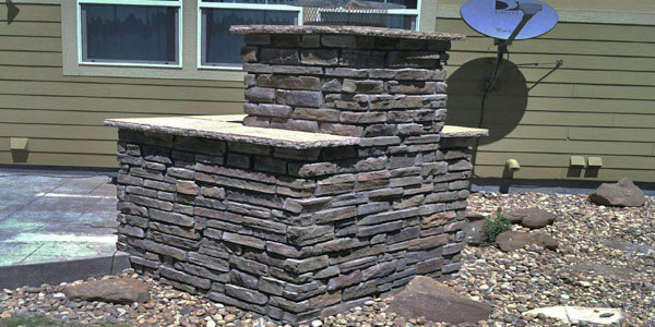 Backyard outdoor fireplace installation Denver, CO.