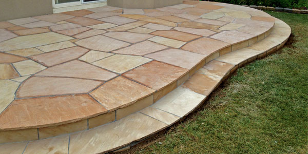 Curved flagstone patio in Denver, CO.