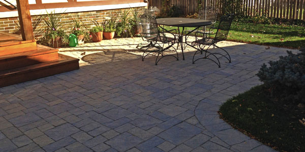 Stone patio designed and installed by Backards Plus.