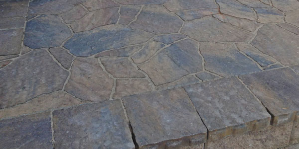 Close up of stone patio installation by Backyards Plus.