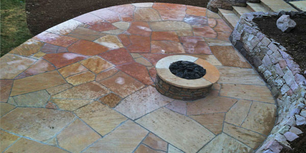 Bird's eye view of a flagstone patio by Backyards Plus.