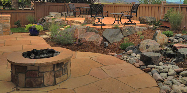 Landscaping featuring flagstone by Backyards Plus.