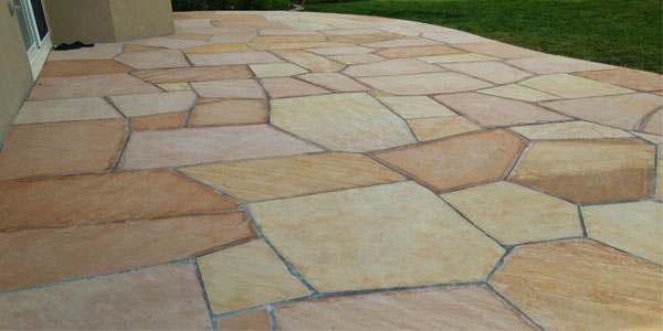 Custom flagstone installations by Backyards Plus.