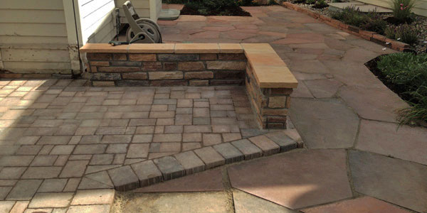 Flagstone and stone patio with seating wall.