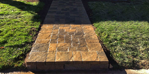 Stone walkway to home entrance in Denver, CO.