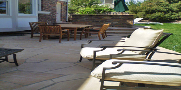 Flagstone patios work well with the natural environment in Denver, CO.