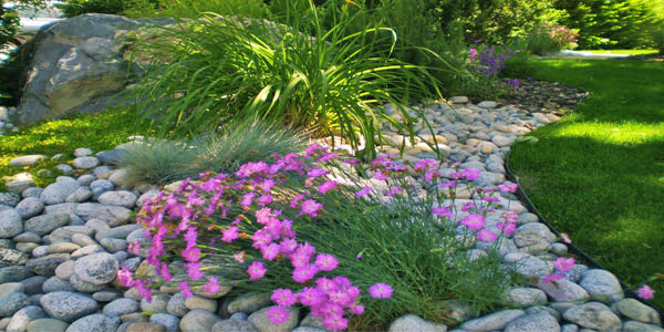 Landscaping with river rock in Denver.
