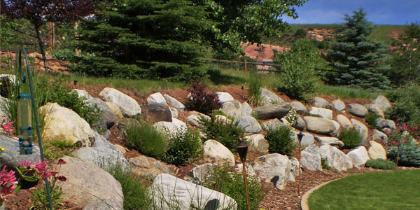 Backyards Plus is Denver's boulder placement experts in landscaping.