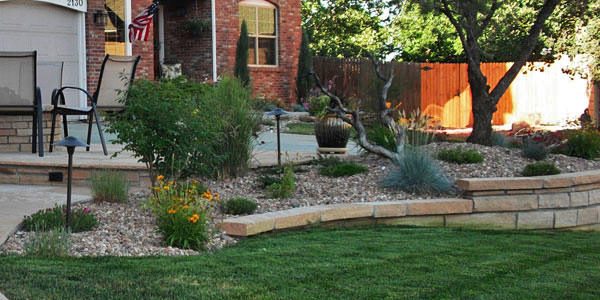 Landscaping and retaining walls by Backyards Plus.