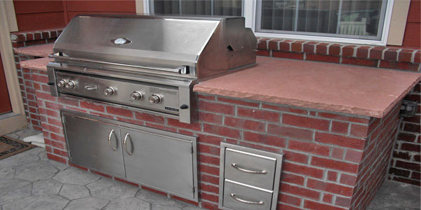 Outdoor kitchen with brick finish in Denver, CO.