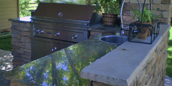Outdoor living are with built in grill Denver, CO.