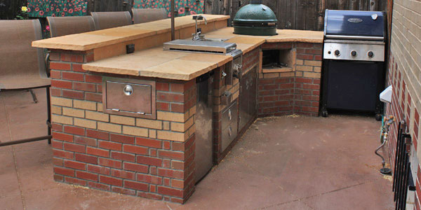 Bar counter designed into outdoor kitchen.