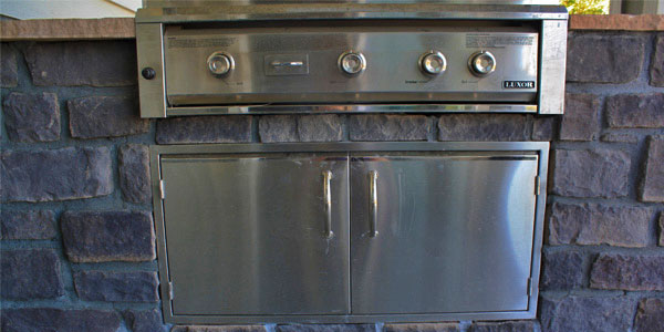 Close up of built in drawers in an outdoor kitchen designed and built by Backyards Plus.