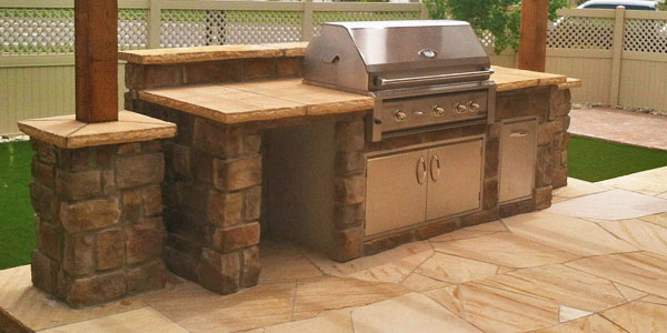 Outdoor kitchen under a pergola in Denver, CO.