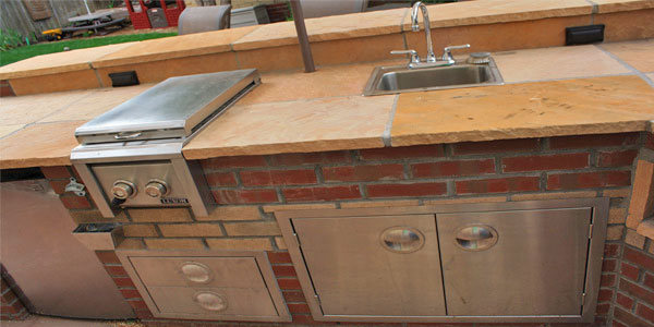 Denver outdoor kitchen with sideburner and sink.