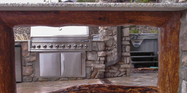 Custom outdoor kitchen designs by Backyards Plus.
