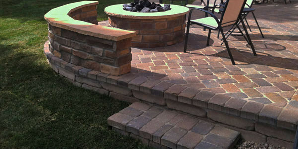 Rounded patio with rounded wall.